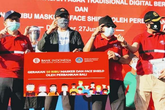 Foto: 200 RIBU QRIS POS BALI/IST ANGGOTA Komisi XI DPR RI Dapil Bali, I Gusti Agung Rai Wirajaya bersama Direksi dan jajaran Bank BPD Bali saat Peresmian Pasar Sindu sebagai kawasan pasar tradisional digital berbasis QRIS.