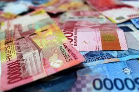KEPALA Dinas Koperasi UMKM dan Nakertrans Bangli, Luh Ketut Wardani, mengakui banyak persoalan terjadi dalam penyaluran stimulus. Ilustrasi uang. Foto: net