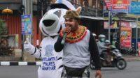 BONDRES Polres Gianyar edukasi masyarakat tentang prokes pencegahan Covid-19. Foto: adi