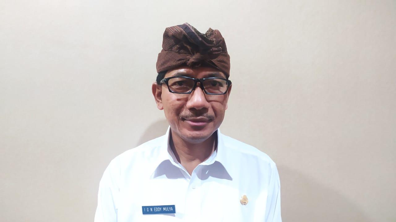 Plt. Kepala Dinas Pendidikan Kepemudaan dan Olahraga Kota Denpasar, IGN Eddy Mulya. Foto: tra
